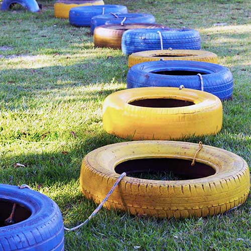 Tyre spoon game for corporate events Tyre huddle game